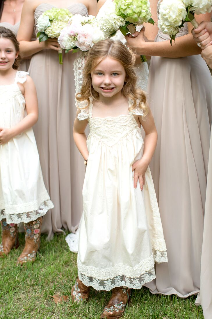 50c90c5c8d1 Amanda and Nic s two flower girls wore ivory A-line dresses and cowboy  boots for