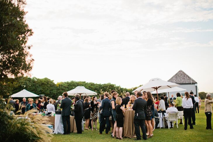 After exchanging vows at the basilica, friends and family celebrated the newlyweds with a cocktail hour and reception on Figure 8 Island's intracoastal waterway.