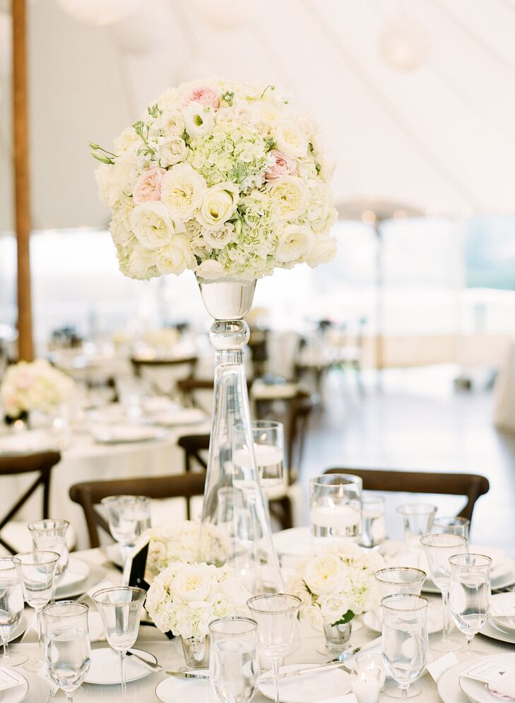 With the help of planner Zoe Ross of ZBR Events and the talented florists at Flowers on the Vineyard, the couple made the venue their own with a color palette of soft champagne, ivory and blush hues and lush, varied arrangements of roses and hydrangeas that gave the reception tent texture and dimension.