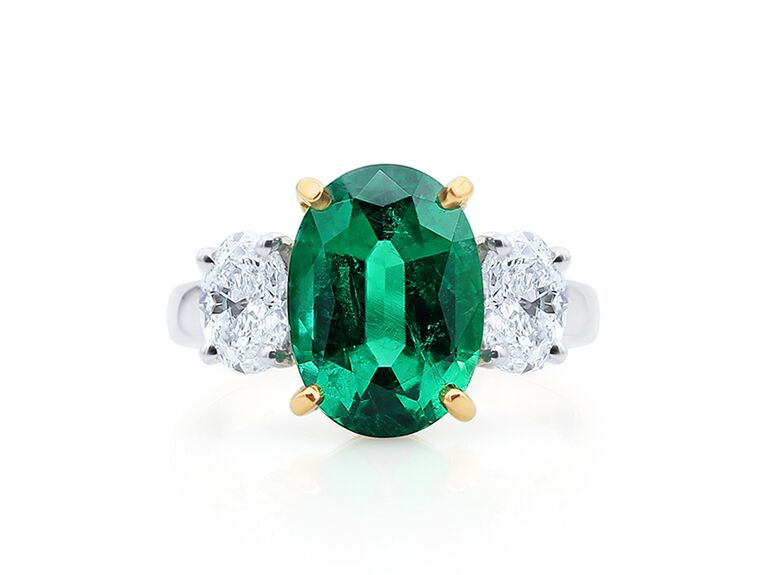 Emerald and diamond engagement ring on yellow gold band