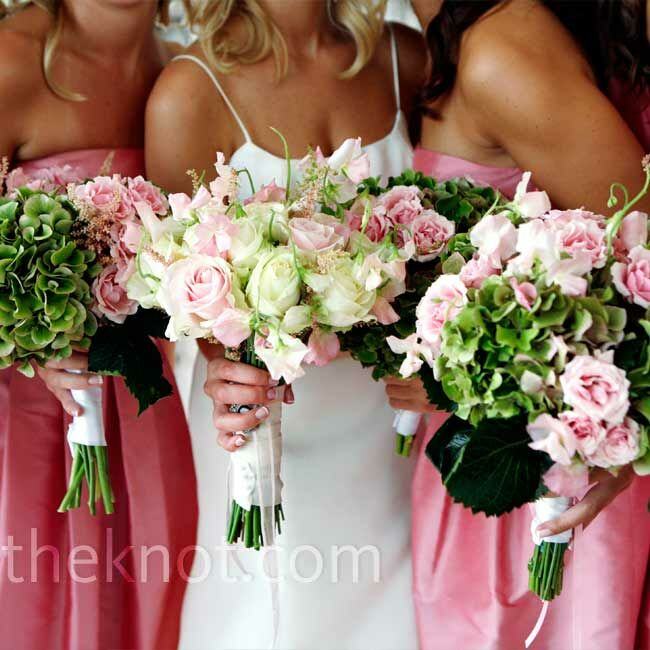 Roses, heather, and sweet peas made up the bride's bouquet, which had her grandmother's brooch pinned onto the wrap. The bridesmaids held roses, heather, and hydrangeas.