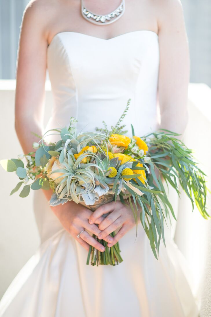 """The flowers for the bridal bouquet had an asymmetrical loose shape to it, as though the flowers and leaves were picked straight from a garden,"" says Maddy, who asked Angella Floral Arts in San Anselmo, California, to help create her greenery-filled bouquet, which was made with billy balls, dusty miller, air plants, succulents and eucalyptus."