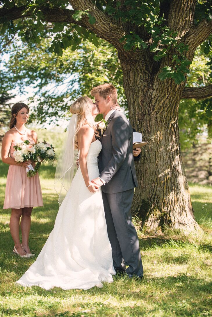 The bride's grandfather performed the ceremony for the newlyweds under a tree at Five Lakes Resort.