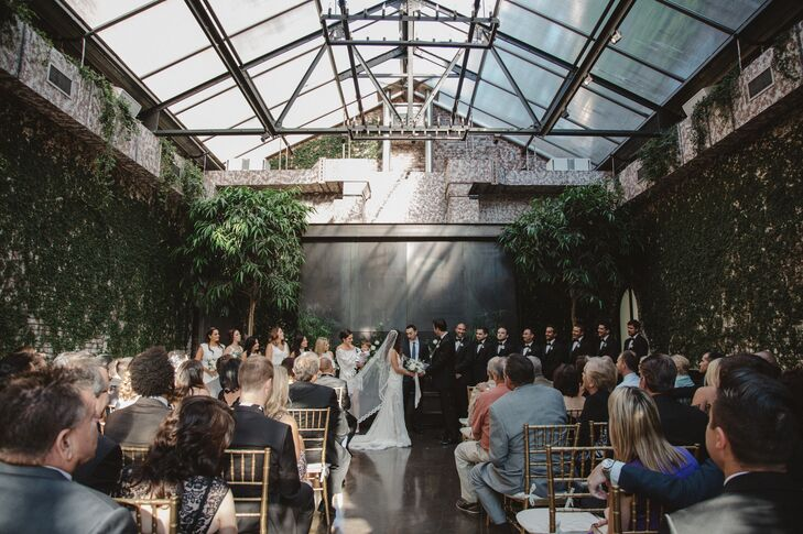 "Nancy and Michael exchanged vows in the Foundry's Green Room, which is built with a stunning, greenhouse-like skylight. ""We chose the Green Room because of the skylight that spread across the entire ceiling, which fed the room with light,"" Nancy says."