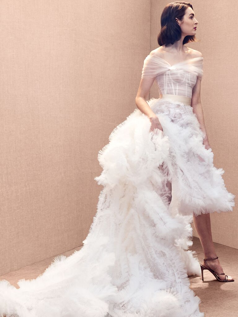 Oscar de la Renta Spring 2020 Bridal Collection wedding dress with ruffled skirt and asymmetrical fitted bodice