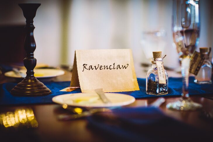 Guests were assigned to one of four long family-style tables, each designated and decorated as one of the Hogwarts Houses.