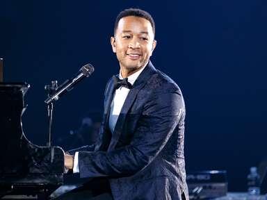 John Legend performing at piano