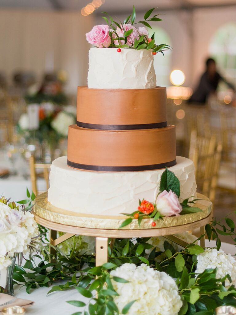 Vanilla and chocolate wedding cake with pink roses and berries