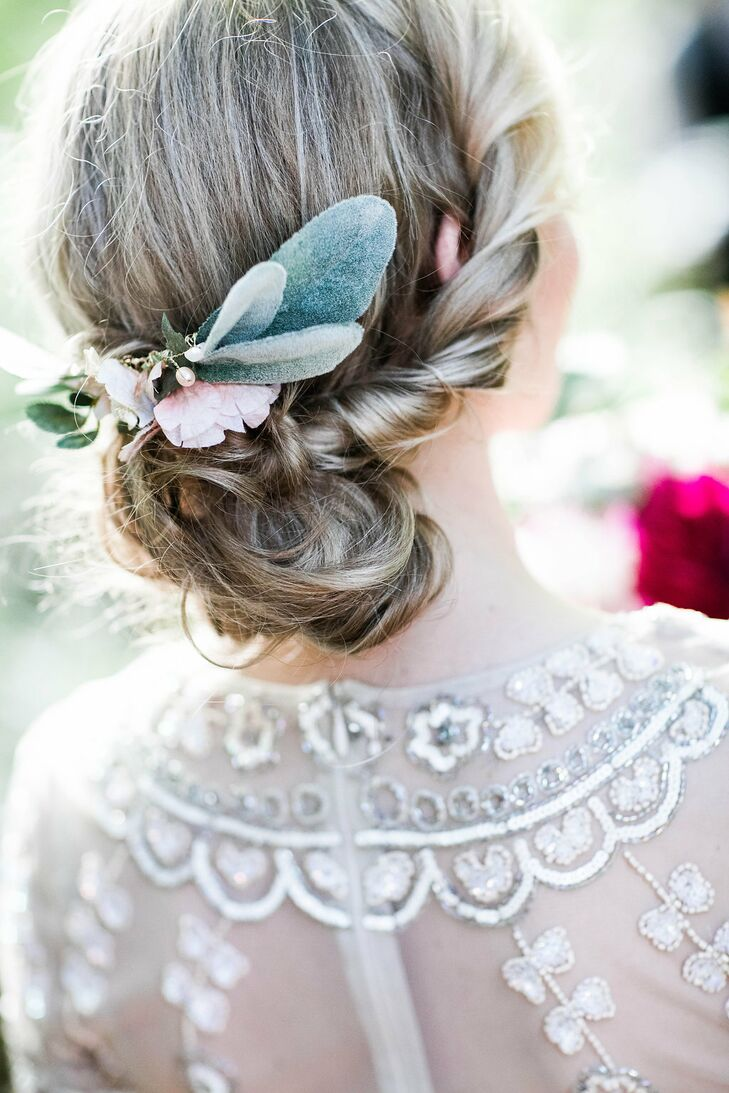 """I used a flower hair comb from a local jewelry shop I found on Etsy and created a natural chignon with braids and twists,"" says Alicia, whose relaxed updo allowed her vintage-style lace gown to shine."