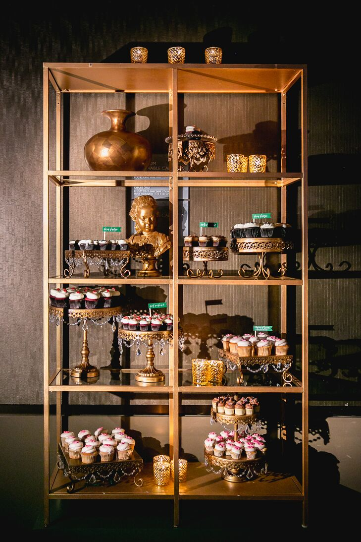 A tall gold stand displayed a large assortment of Georgetown Cupcakes, Maura's all-time favorite dessert. They picked out four flavors for guests to choose from: cherry blossom cheesecake, chocolate ganache, birthday cake and red velvet.