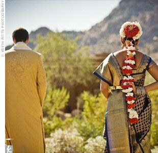 Red and yellow accents really popped against the greens and browns of the wedding day's desert background.