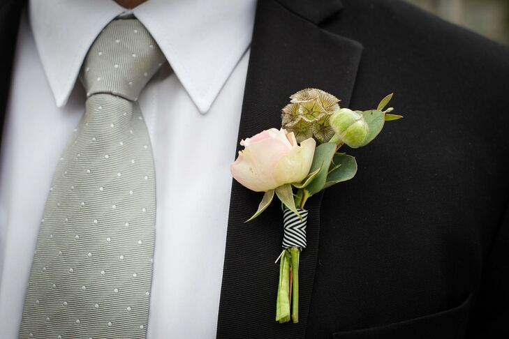 The boutonniere featured a white rose paired with a scabiosa pod.