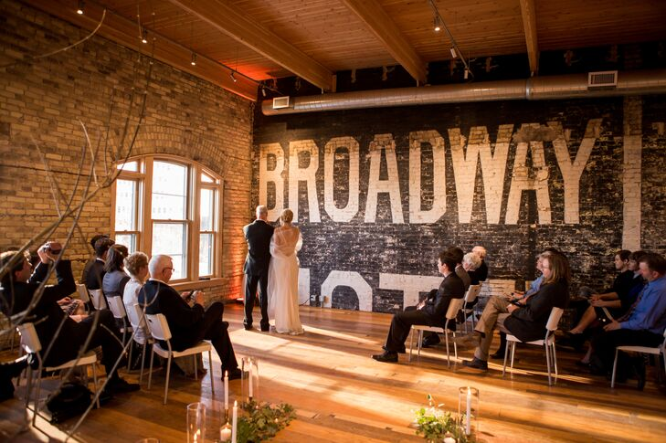 The intimate ceremony took place on the second floor of the art gallery. Brick walls and natural sunlight added warmth to the room.