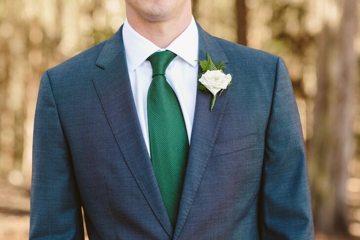 58b98c783bc8 Pat wore a charcoal gray suit designed by Hugo Boss on the wedding day,  complemented