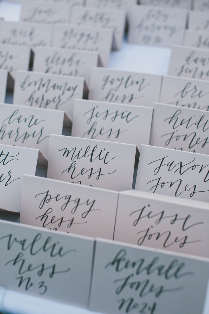 """We had blush pink escort cards with each guest's name written by a calligrapher,"" Elle says. ""It was a really special detail that I know guests enjoyed—we even had guests tell us they saved theirs."""