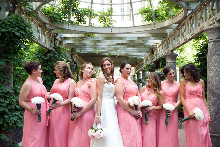 The bridesmaids wore long coral pink dresses.