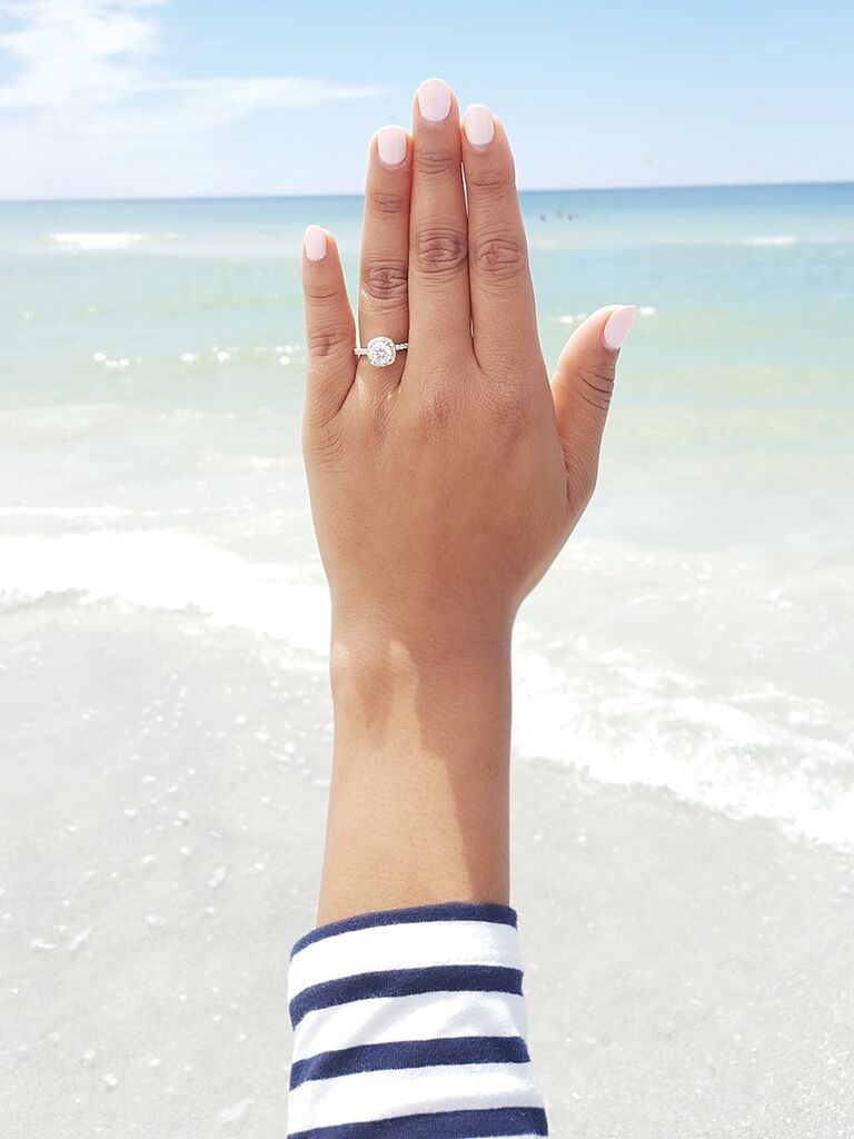 Engagement ring selfie idea with a beachy background
