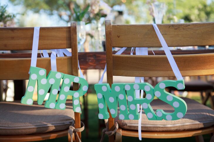 To set their seats apart from the rest, Maggie and Joseph hung playfully polka-dotted Mr. and Mrs. signs from their chairs.