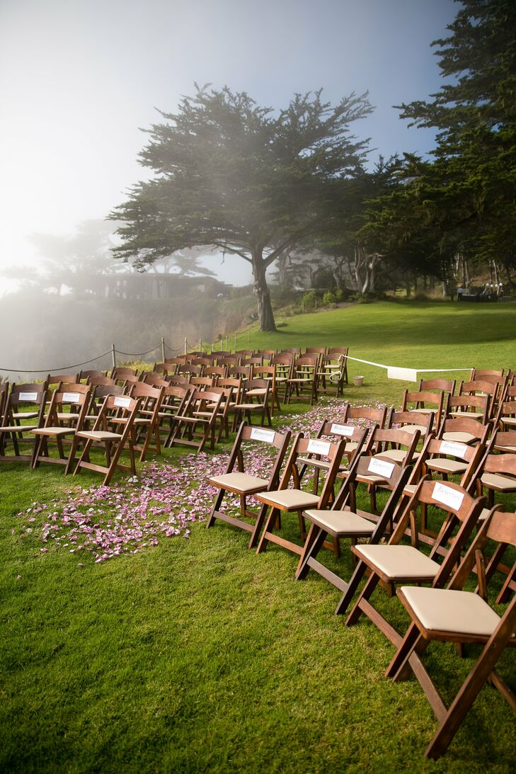 Guests sat on dark wooden folding chairs during the ceremony.