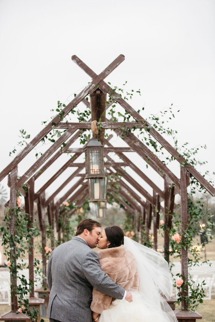 """In an unforeseen twist, the temperature dipped down to 40 degrees for Jessica and John's wedding weekend. """"My favorite part of the day was walking down the aisle and looking at John. I didn't have a chill on me,"""" Jessica says."""