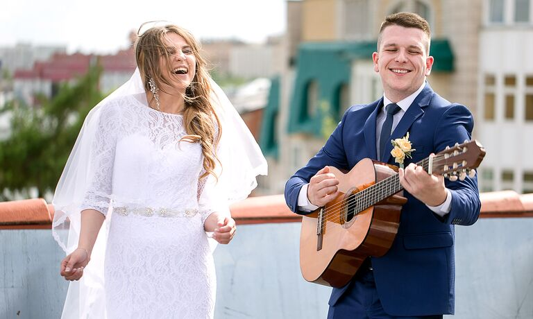 Couple playing alternative wedding songs