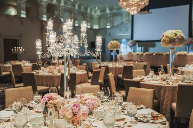 Crystal candelabras were paired with low, small pastel rose centerpieces for a sophisticated, romantic look.