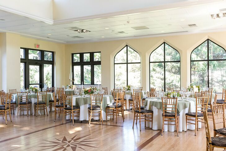The reception took place in the ballroom at Aldie Mansion in Doylestown, Pennsylvania. Dining tables were covered in sage tablecloths and arranged with chiavari chairs for the event.