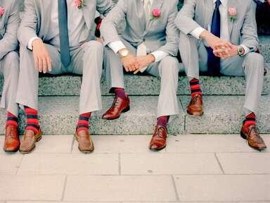 Groom and groomsmen wearing fun wedding socks