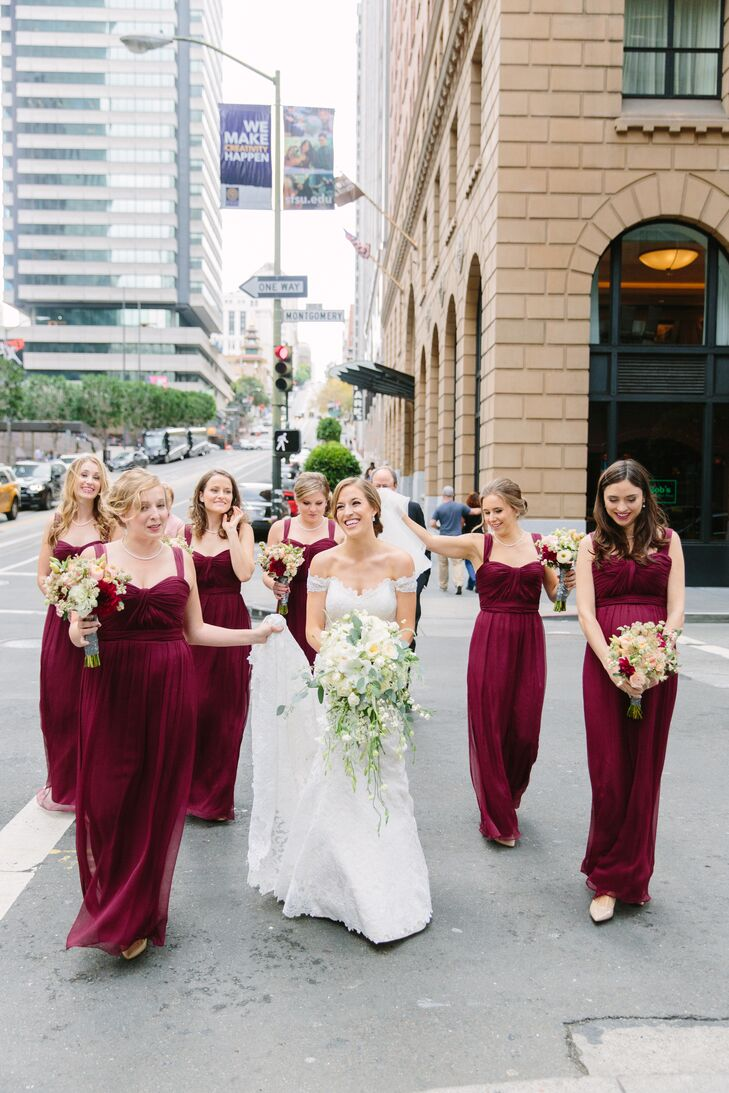Meghan's bridesmaids wore full-length crimson gowns by Amsale paired with varying hairstyles.
