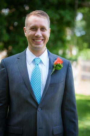 Groom in a Blue Tie and Coral Boutonniere