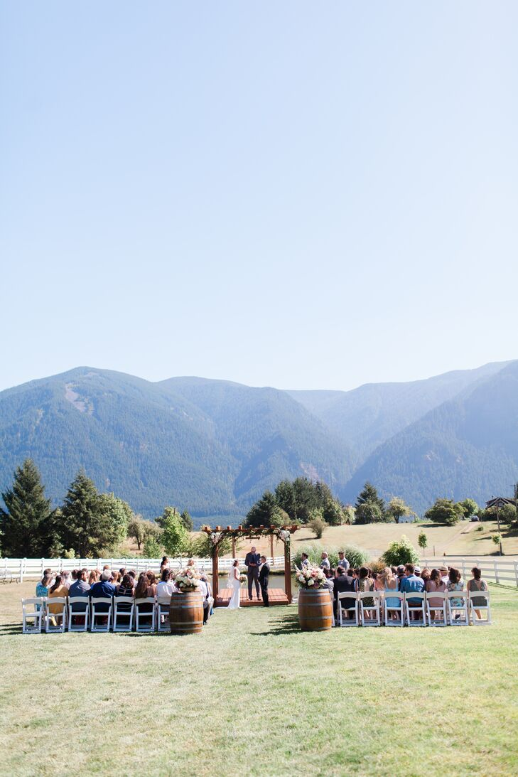 Exquisite mountain views served as an unforgettable backdrop to Eliza and Jake's outdoor ceremony at Wind Mountain Ranch in Stevenson, Washington.
