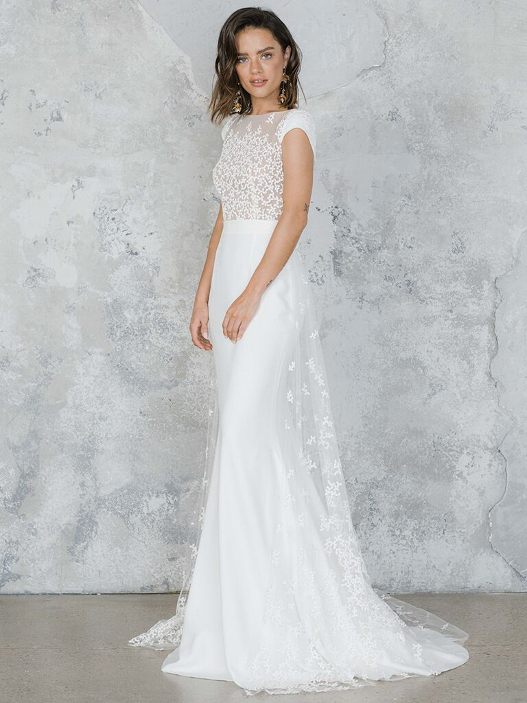 Fitted dress with high neckline and embroidered sheer bodice