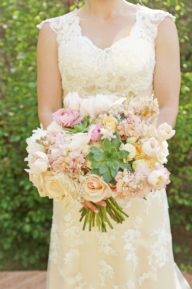 Ashlee carried a lush bouquet of blush flowers, including spray roses, stock, parrot tulips, astilbes and ranunculus. Green succulents added a Utah touch.