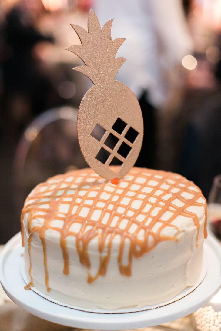 A gold lasercut pineapple topped one of Kelly and Adam's 16 wedding cakes; there was one for each table.