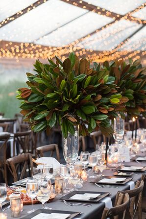 Tall Magnolia Leaf Centerpieces Atop Cool-Gray Linens