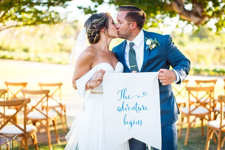 """Traveling is something I love to do, and it was a big part of our relationship, so it all just seemed perfect,"" Taylor says of their nuptials at Flora Farm in San Jose del Cabo, Mexico. The newlyweds embraced their wanderlust by holding a sign that read ""The Adventure Begins."""