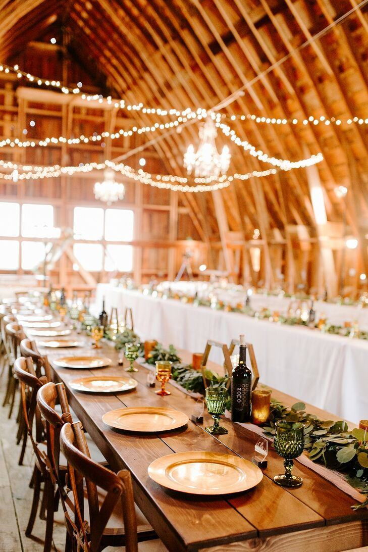 Rustic Reception with Farm Tables, Vintage Glassware, String Lights and Greenery Garland