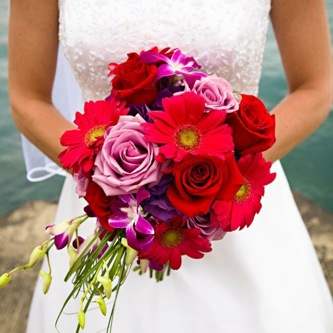Ideal for a summer wedding, Carrie's hand-tied bouquet contained a mix of daisies, roses, hydrangeas, and dendrobium orchids.