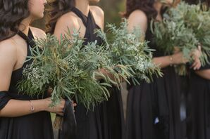 Bridesmaids in Black Gowns Carrying Greenery and Baby's Breath
