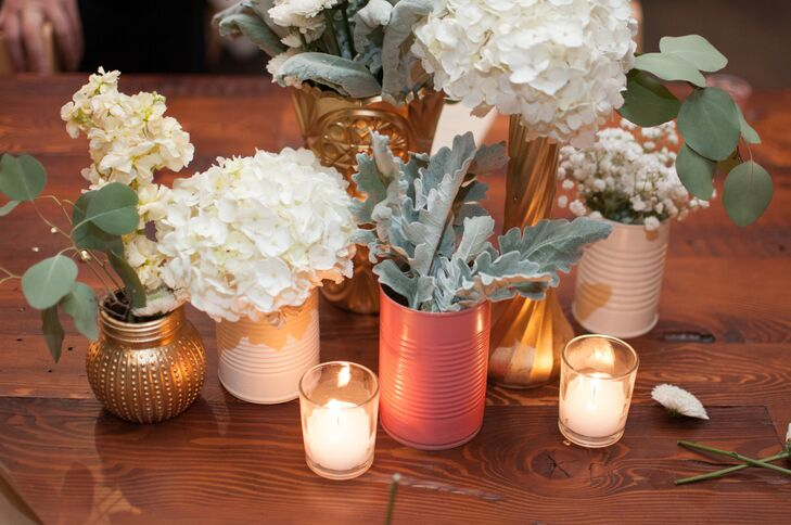Blush Custom Weddings acted as Samantha and Ben's wedding-day florist and created centerpieces using white hydrangeas, baby's breath and dusty miller and placing them in mismatched coral, white and gold vases. Surrounding tea-light candles created a romantic, intimate ambiance.