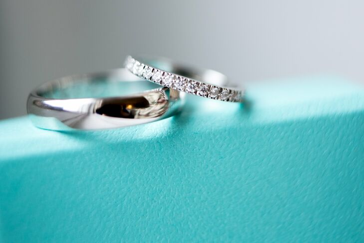 Brigid paired her vintage-inspired cushion-cut solitaire Tiffany engagement ring with a matching delicate diamond band.