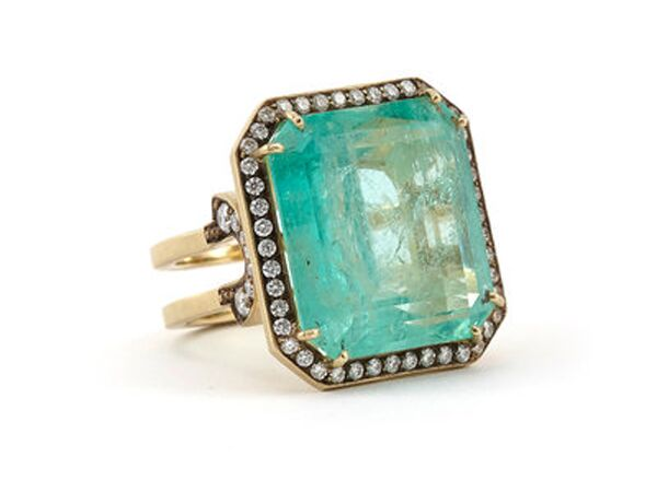 Colombian emerald engagement ring with halo
