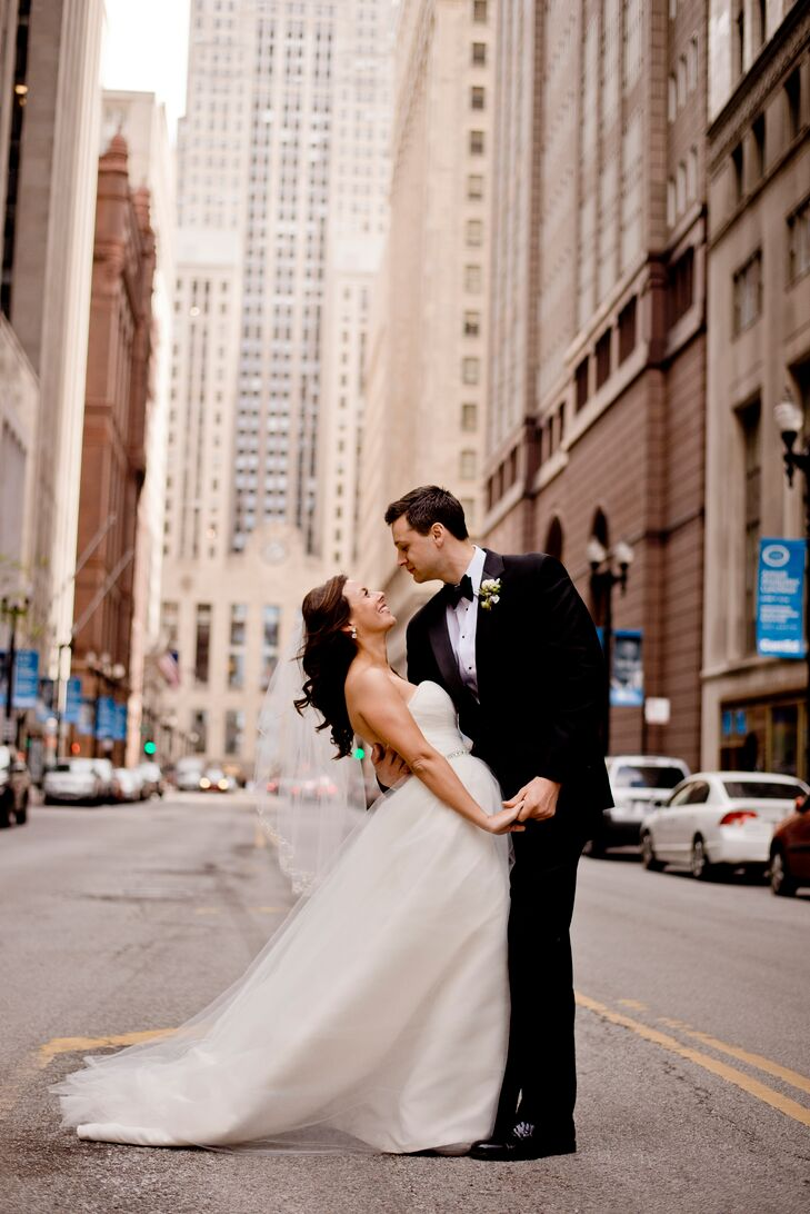 """Lindsay purchased this strapless Amy Kuschel ball gown from the Gown Shop in Ann Arbor, Michigan. """"The timeless style of the dress was what I had always envisioned when I thought about the perfect bride,"""" she explains."""