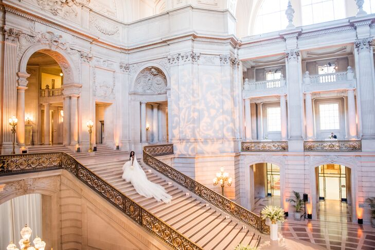 """San Francisco City Hall's marble staircase and rotunda sold the couple immediately and influenced the invitations' gold crest. """"It is indeed the crown jewel of the city, a place where we can return year after year to relive our amazing wedding memories,"""" Beth says."""
