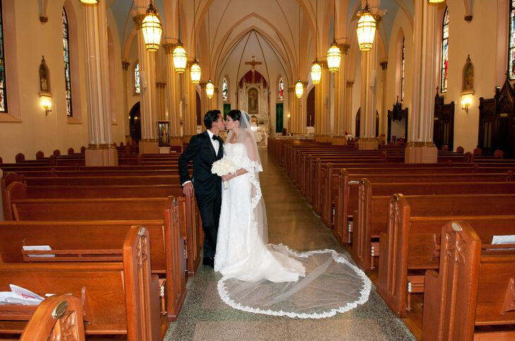 Ana Rita wore a strapless Demetrios gown with a lace overlay. Her custom made veil was thirteen feet long!