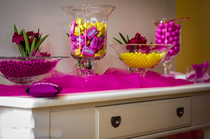 At the reception, Amanda and Jason treated their guests to a candy bar with hot pink and yellow sweets.