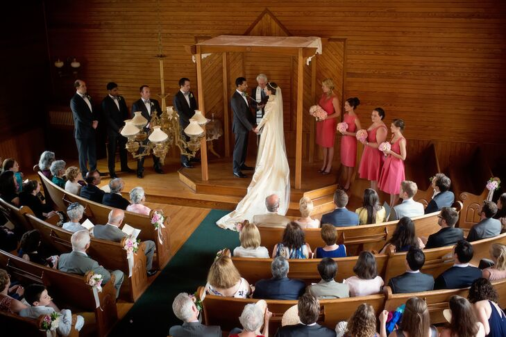 """""""We knew we wanted a Jewish ceremony, but we also wanted to honor the Hindu, Muslim, and Christian backgrounds of our parents,"""" says Nellie. """"Bob Alper, the rabbi who named me as a baby, happens to be a stand-up comedian in Vermont, and came out of retirement to officiate our ceremony.""""  The couple stood under a custom wooden chuppah, covered by a lace tablecloth belonging to Nellie's grandmother."""
