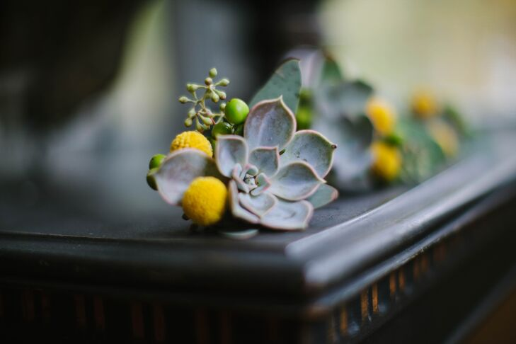 The groomsmen wore textured succulent billy ball and succulent boutonnieres.