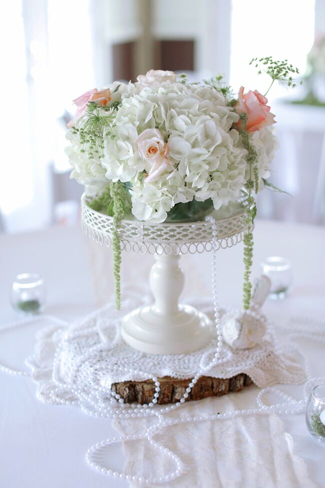 vintage inspired rose and hydrangea centerpiece with pearls rh theknot com