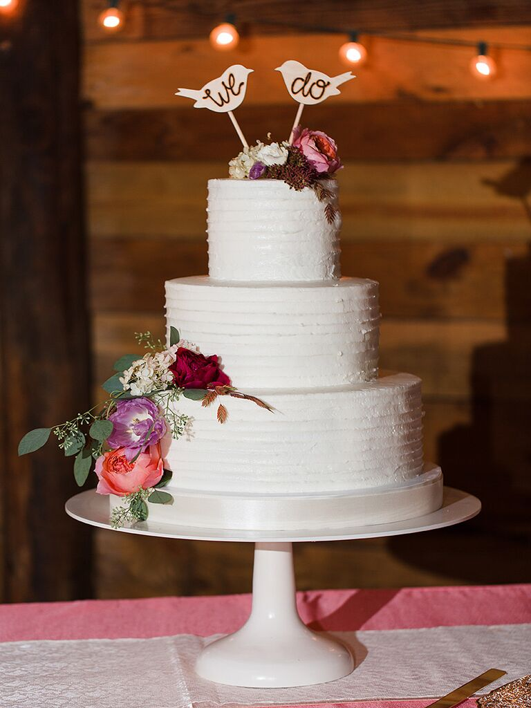 Rustic fall wedding cake with bird toppers